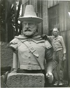 Sculptor John Horrigan with Myles Standish's head, 1930.
